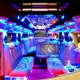 Luxury in the limo: the white one\'s front part - Hummer H2 Limo Transfer