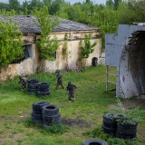 Takes place outdoor at an old stone mine - Paintball
